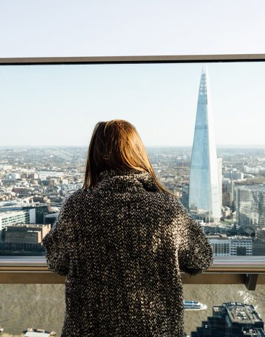 Woman looking out over the London Skyline.